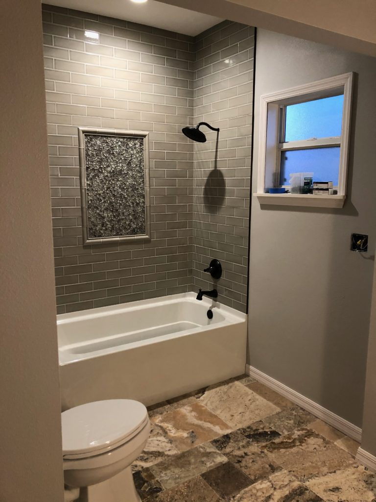 New tub and subway tile with glass mosaic