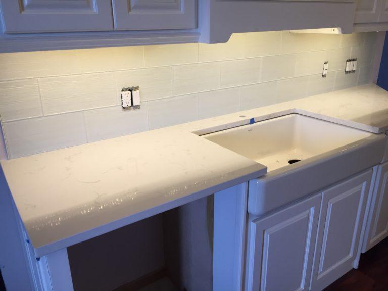 led lighting glass backsplash and quartz countertops