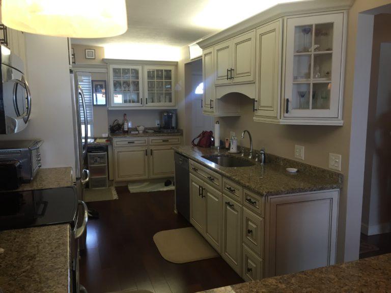 led lighting glass backsplash and quartz countertops white appliances glass cabinets