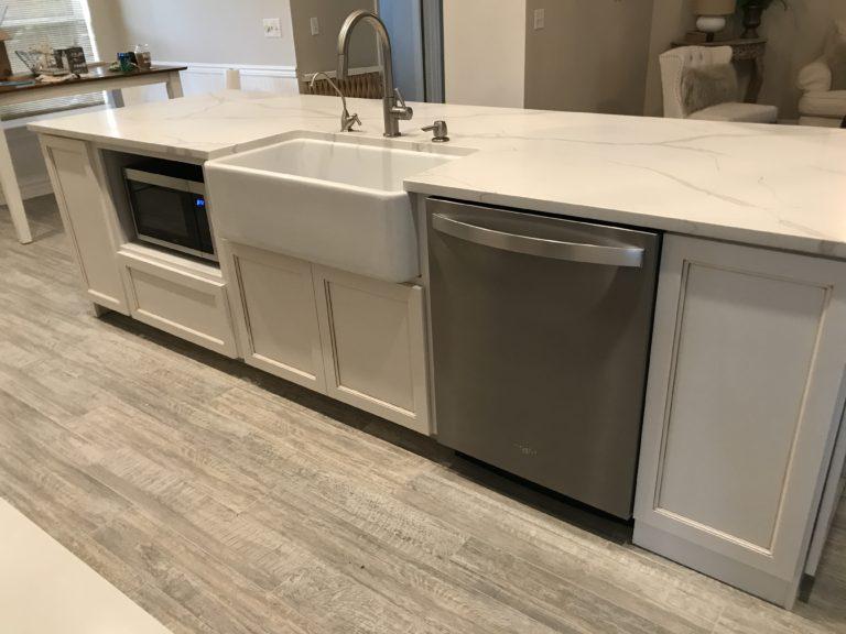 Kitchen finished stainless steel appliances subway tile quartz countertop farmhouse sink