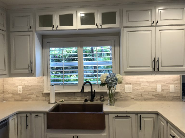 Quartz countertops stone backsplash white cabinets copper farmhouse sink