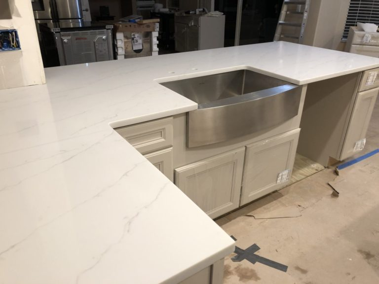 Stainless steel farm sink with quartz top